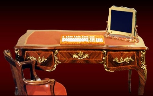 Gold-plated computer inspired by Louis XV and Empire