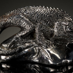 Meteorite Carving of Lizard. Carved from a Campo del Cielo meteorite from Argentia, this carving, by Santa Barbara artist, Ronald Stevens.