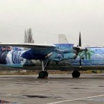Two airplanes decorated with graffiti