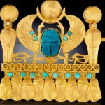 An Egyptian Revival Gold and Scarab Brooch