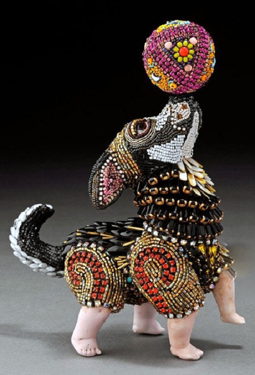 A puppy playing with a ball. Huichol art