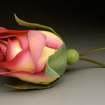 A rose Evening Bag by American clay artist Kathleen Dustin