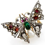 Diamond, emerald, natural pearls, garnet, yellow brooch of gold and silver, the end of XIX