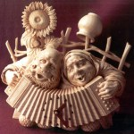 Playing the accordion. Wood sculpture from 'Hours of Russian soul' collection by Yuri Firsanov