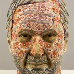 Vincent. 2008. Recycled wood, pigmented grout. Male head. Sculpture by American artist Michael Ferris Jr