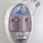 Decorative masked face. Work by Californian artist Peggy Bjerkan
