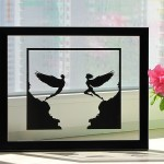Two angels Paper silhouette by artists Dmitry and Julia