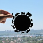 Animals walking round the earth. Paper silhouette by artists Dmitry and Julia