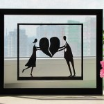 A couple holding a broken heart. Paper silhouette by Dmitry and Julia