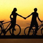 A girl and a boy on their bikes. Paper silhouette by Dmitry and Julia