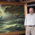 Russian artist Georgy Dmitrievnext to his painting