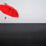 Minimalism genre. Red umbrella by Canadian photographer Andre Villeneuve
