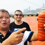 One Chinese man demonstrates the color of the water taken from the river Yangtze in China