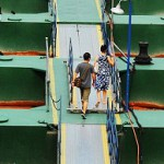 Walking on the bridge couple. The river Yangtze in China turns a bright shade of orange-red
