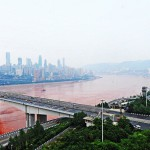 Panoramic photo of the river Yangtze in China, that turns a bright shade of orange-red