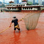 Catching fish in the orange-red river. China