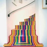 these colorful striped steps are actually just covered in vinyl tape by Scottish Artist Jim Lambie.