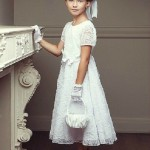 All in white. Fashion photo of Anastasia Bezrukova, beautiful Russian 8-year-old model