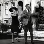 Peppard and Hepburn walking down the street