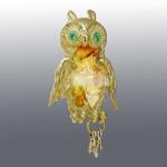 Brooch. Emerald, Opal. Material Gold 750