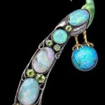 Guild of Handicraft Brooch In the form of a Peacock Standing on an opal orb