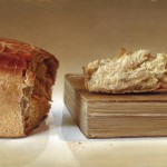 Loaf of bread and a book. Still life