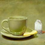 Tea bag, lemon and a cup. Still life