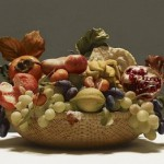 Grapes and fruit in a Basket. Still life. Hyperrealistic painting by Italian artist Luciano Ventrone