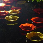 Night view. Colorful installation of umbrellas by UK-based artist Luke Jerram