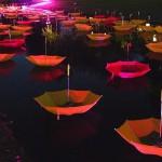 Scarlet sails. Colorful installation of umbrellas by UK-based artist Luke Jerram