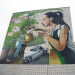 Watering flowers. MOST Moscow Street Art Festival
