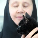 Black cat and Orthodox nun