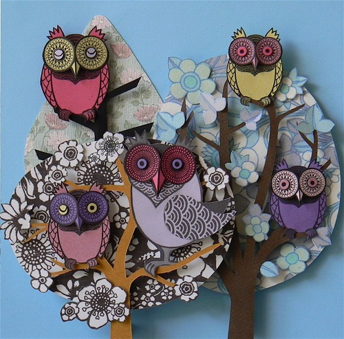 Owls in the trees. Paper cut art by British artist Helen Musselwhite