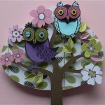 Blooming tree with two owls. Paper art by Helen Musselwhite