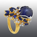 Ring. Stones diamond grit, Sapphire, star-shaped sapphire. Material Gold 585