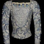 For the role of Prince Siegfried, Act I, in Swan Lake, Vienna State Opera Ballet, 1964. Silver lace and blue silk doublet, trimmed with blue rhinestones, faux pearls, pleated linen collar and cuffs, and blue soutache
