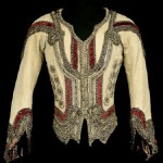 Jean de Brienne in Raymonda, Opera national de Paris, 1983. Beige silk and gold lamé doublet with velvet braid; cream silk shirt with elastic belt