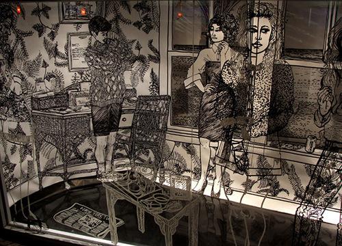 Furnished room. Black marker Drawings on walls by British artist Charlotte Mann