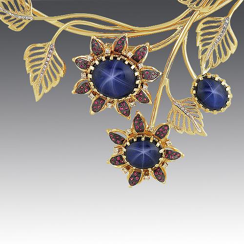 necklace. Stones Diamonds, star-shaped sapphire, rhodolite