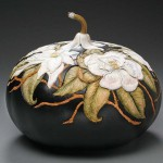 Flowers decorating the vase – art work by pumpkin carver Marilyn Sunderland