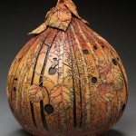 Wood in the fall. Delicate pumpkin carving by American artist Marilyn Sunderland