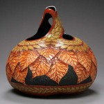 Basket of leaves. Delicate pumpkin carving by American artist Marilyn Sunderland