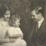 A baby Queen Elizabeth II with her parents in 1927