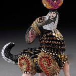 A cute dog playing with a ball. Bead sculpture by American artist jeweler Betsy Youngquist