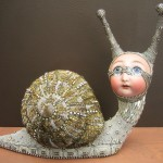 Charming snail sculpture covered with mosaic of bead