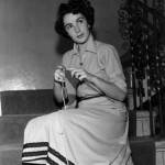 British-American actress Elizabeth Taylor knitting