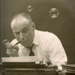 American cartoonist Harvey Kurtzman typing something on his type writer