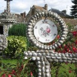 Garden decorated with plates and broken porcelain constructions