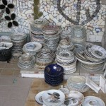 Hundreds of porcelain plates and saucers for future decoration