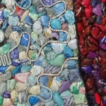 Sheets of Paper, old magazines and newspapers, closeup. Magazine mosaic by Russian artist Vasiliy Kolesnik